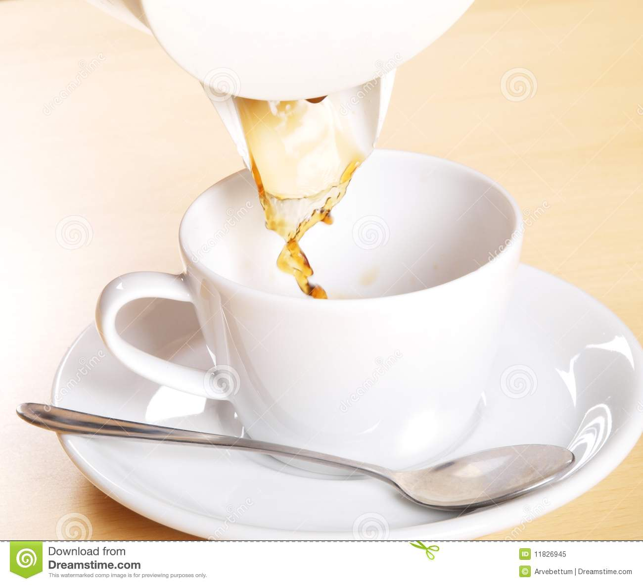 Pouring Coffee White Coffeecup And White Mug With A Tea Spoon On A