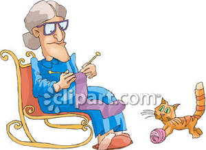 Knitting In Her Rocker With Her Cat   Royalty Free Clipart Picture