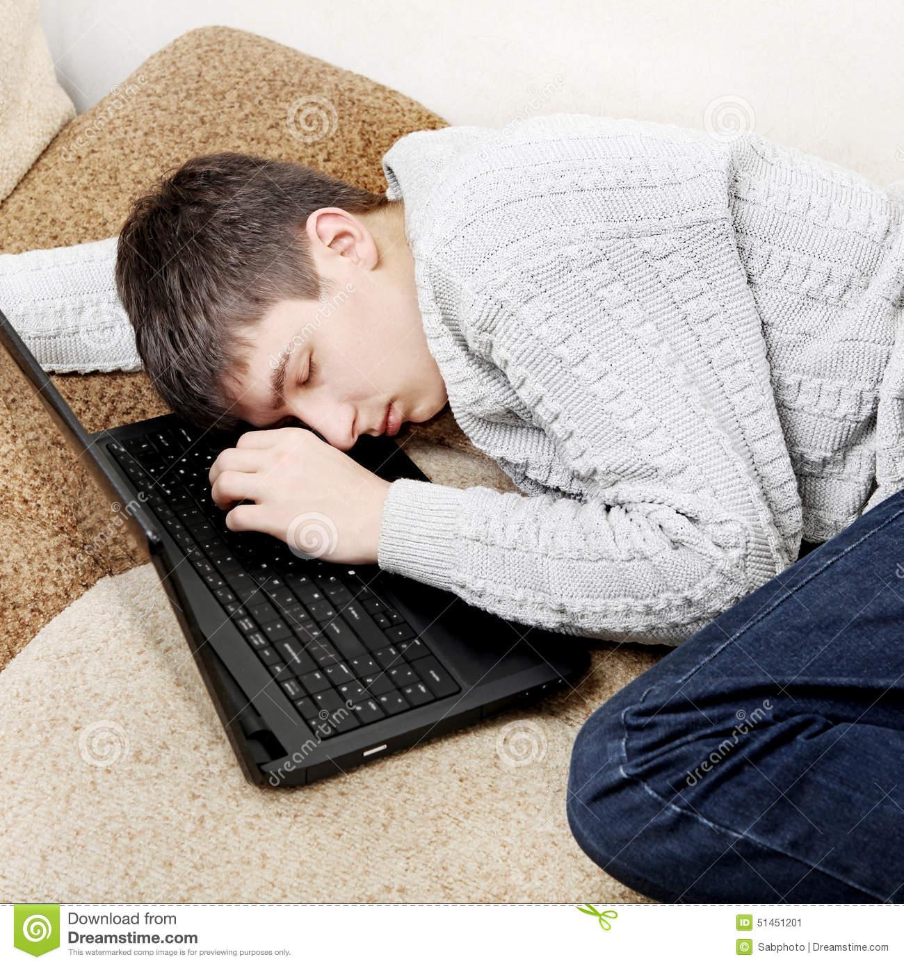 Tired Teenager Sleep With Laptop On Sofa