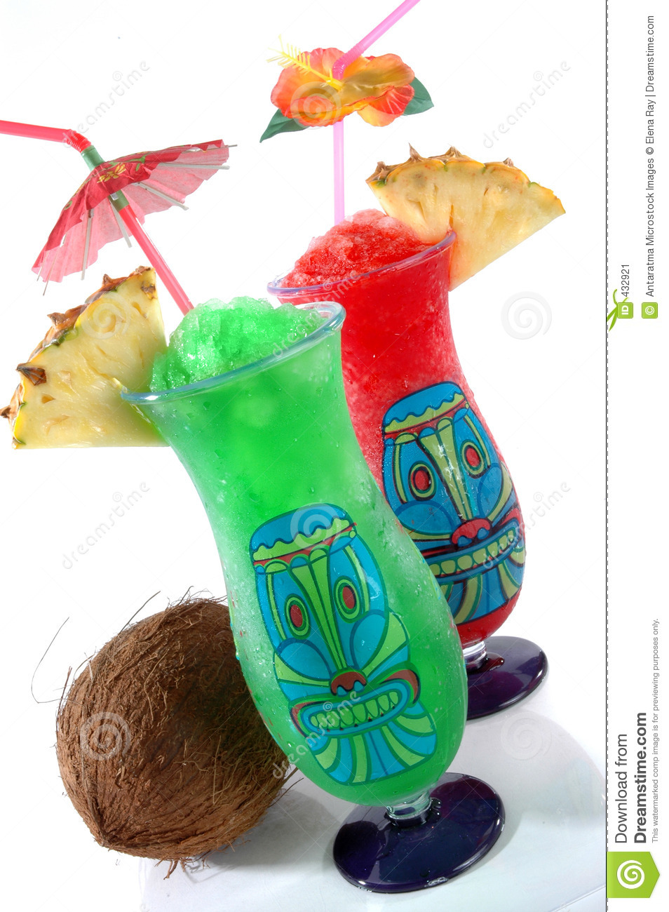 Fun Plastic Tiki Glasses Filled With Colorful Icy Drinks And A Coconut