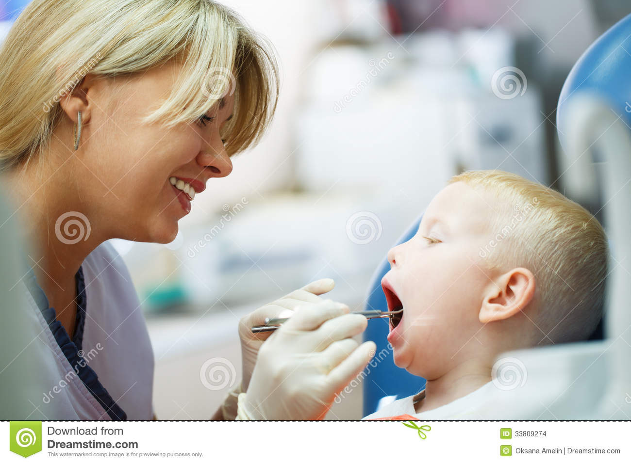 Four Year Old Boy Visits The Dentist At Her Office For A Check Up