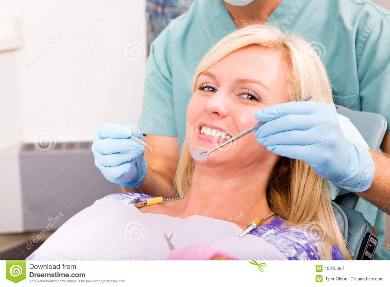 Smiling Woman At The Dentist Ready For A Check Up