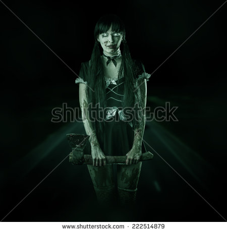 Woman Ghost With Ax On A Night Road In The Headlights   Stock Photo