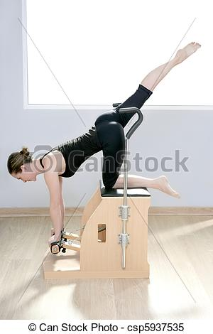 Stock Photo   Combo Wunda Pilates Chair Woman Fitness Yoga Gym   Stock