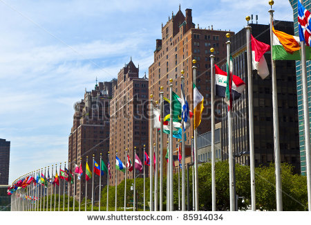 United Nations Headquarters With Flags Of The Members Of The Un Stock