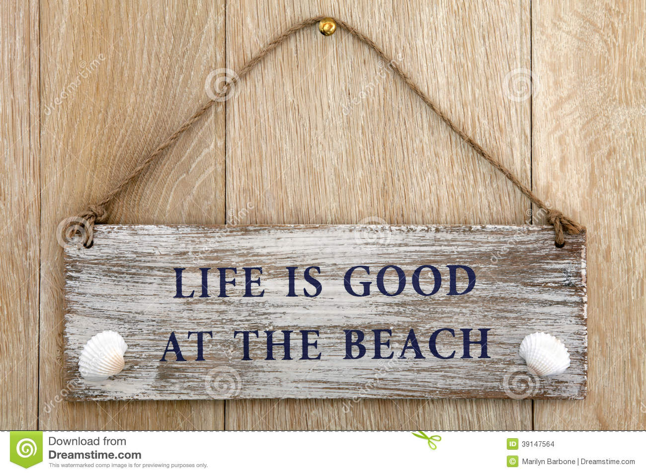 Life Is Good At The Beach Sign Over Oak Wood Background