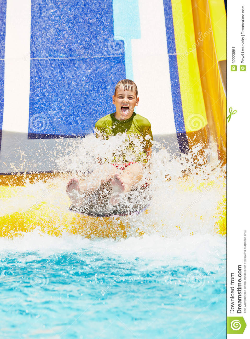 Boy Shouts While Slides Down Water Slide At Summer