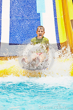 Boy Shouts While Slides Down Water Slide Stock Image   Image  32223851