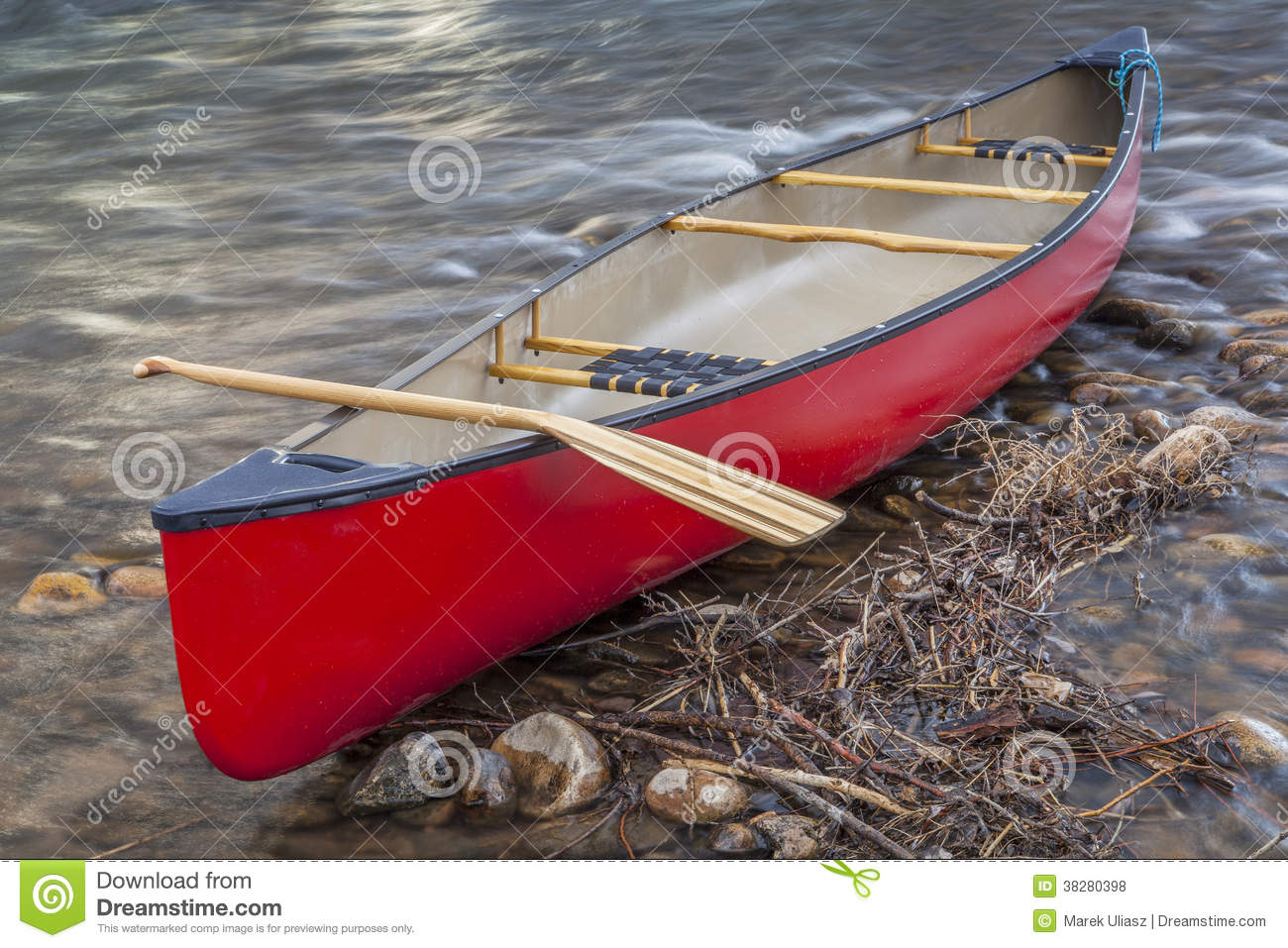 Red Canoe With A Paddle Royalty Free Stock Photos   Image  38280398