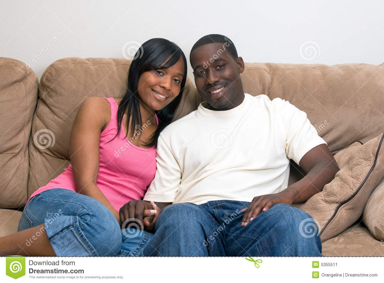 Young Attractive African American Couple Relaxing Together On Their