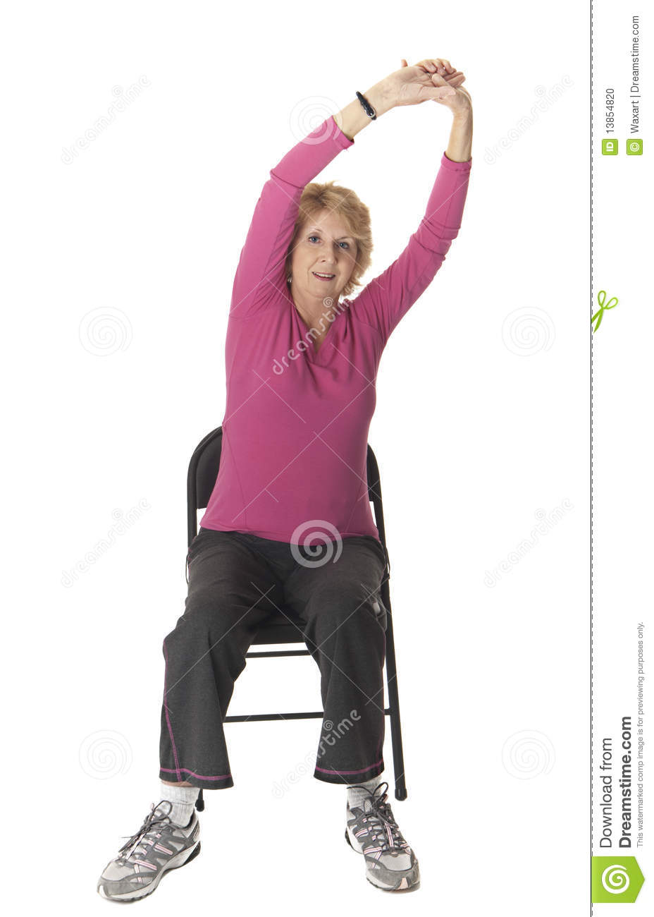 Elderly Woman Stretching As Part Of A Seated Workout Routine To Keep