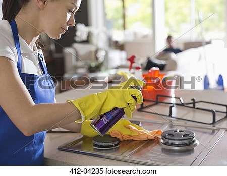 Stock Image Of Maid Cleaning Stove Top 412 04235   Search Stock Photos