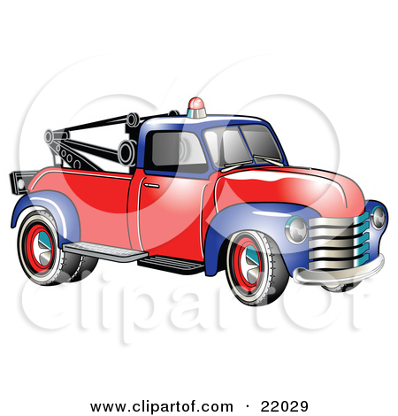 Vintage Blue And Red 1953 Chevy Tow Truck With A Light On Top Of The