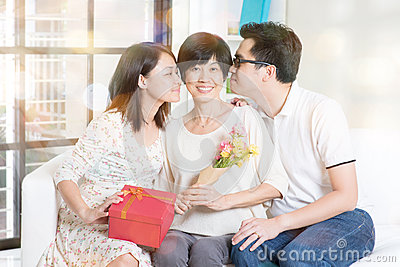 Happy Mothers Day  Asian Boy And Girl Kissing Mother  Family Living