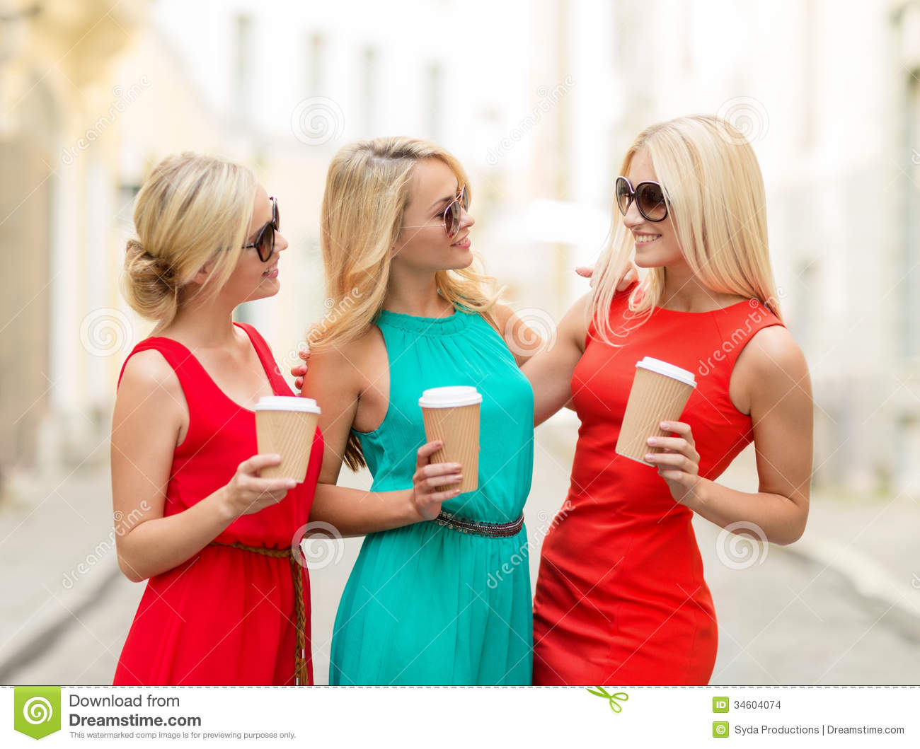 Girls Concept   Beautiful Women With Takeaway Coffee Cups In The City