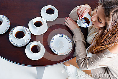 Portrait Of Beautiful Young Woman Drinking Coffee Many Coffee Cups On