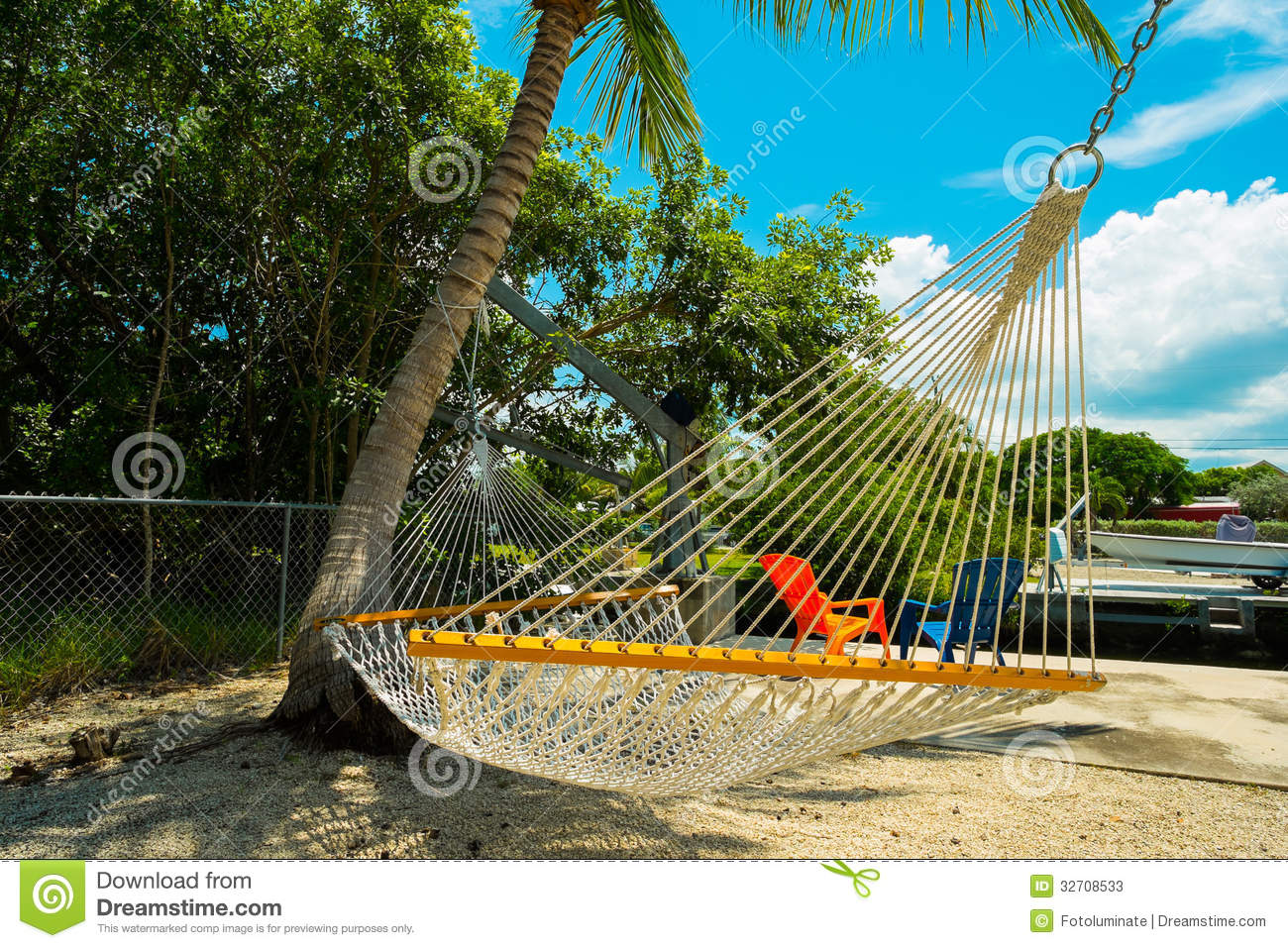 Hammock Hanging From A Palm Tree In The Backyard Of A Florida Keys