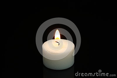 Little Burning White Candle On Black Background