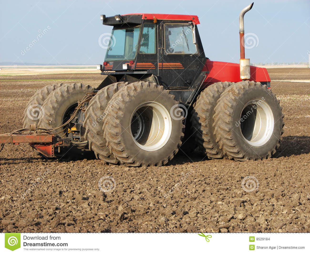 Picture Of A Red And Black Four Wheel Drive Tractor In Summer Fallow