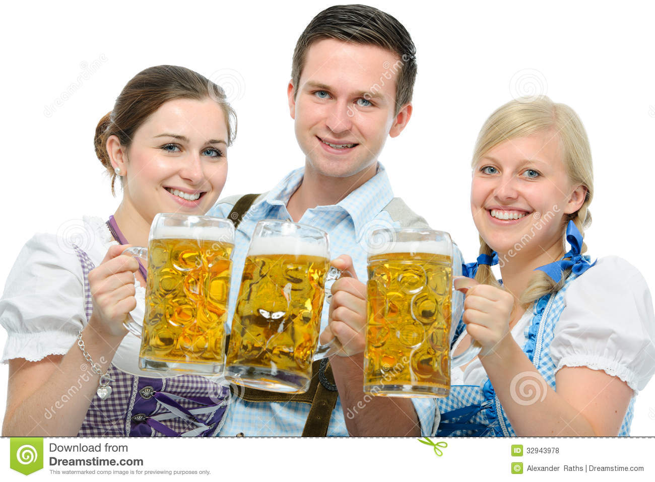 People In Traditional Bavarian Tracht Holding Oktoberfest Beer Steins