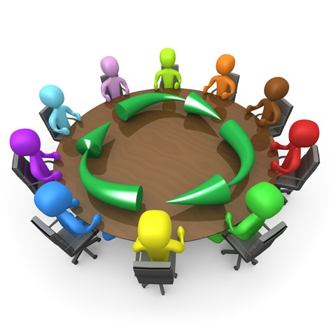 Of A Diverse And Colorful Group Of People Seated And Holding A Meeting