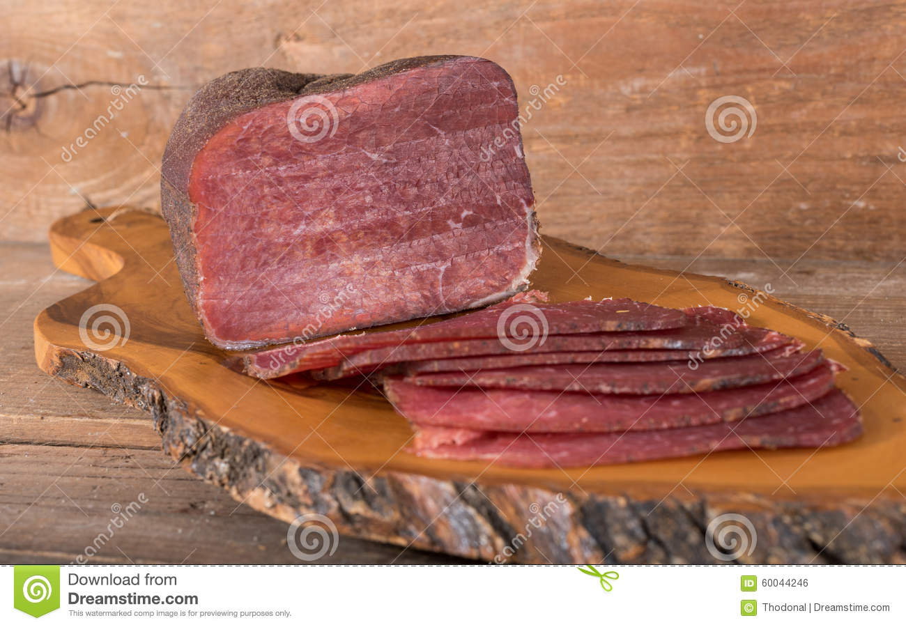 Dried Meat On Wooden Background