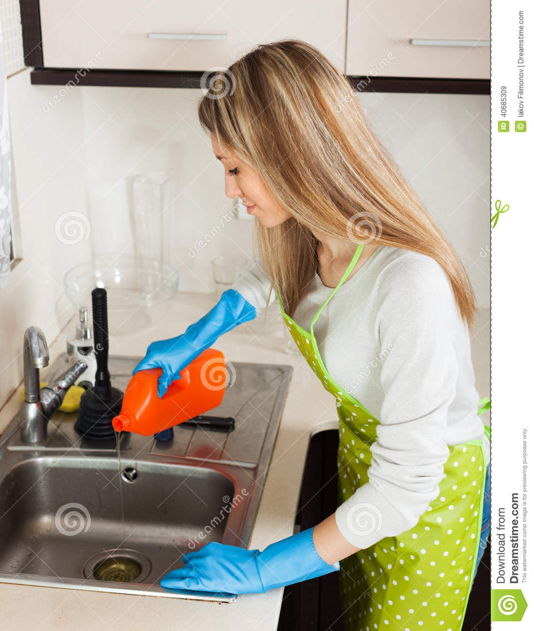 Blonde Woman Cleaning Pipe With Detergent Stock Photo   Image