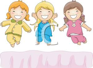 Three Girls Jumping On The Bed At A Pajama Party   Royalty Free