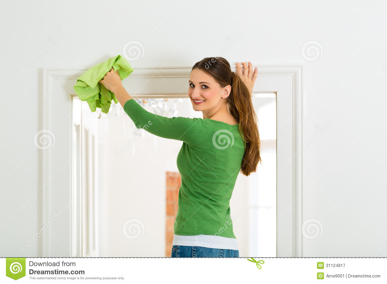 Young Woman Cleaning At Home She Has A Cleaning Day And Using A