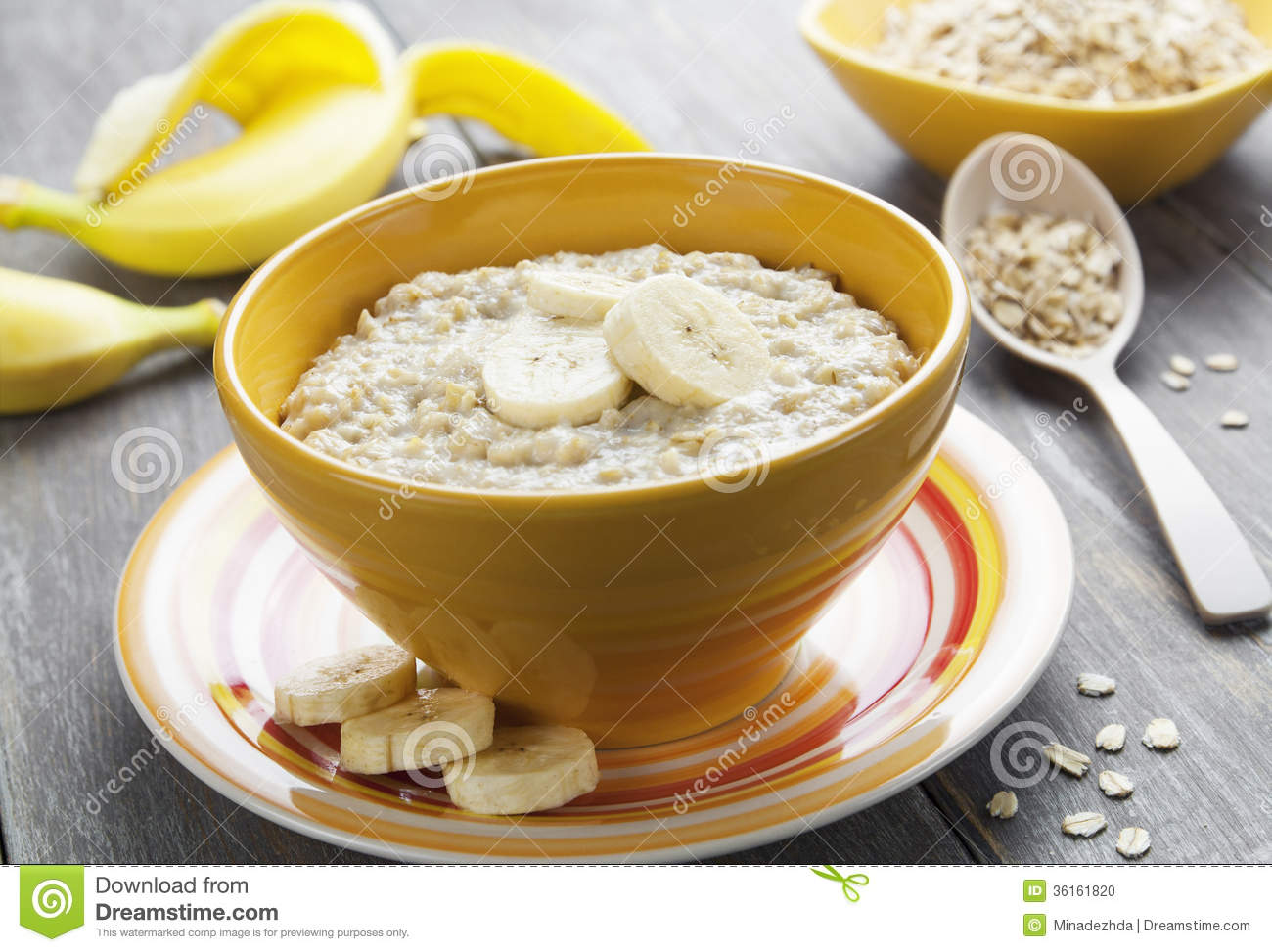 Porridge With Bananas In A Yellow Bowl On The Table