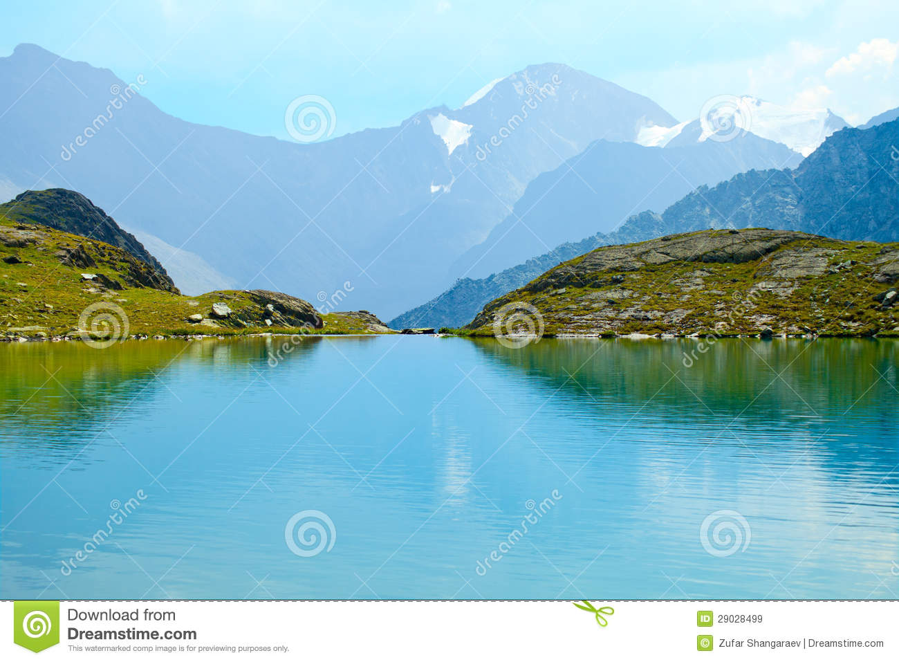 Mountain Range With Its Reflection In The Glacial Lake Altai Siberia
