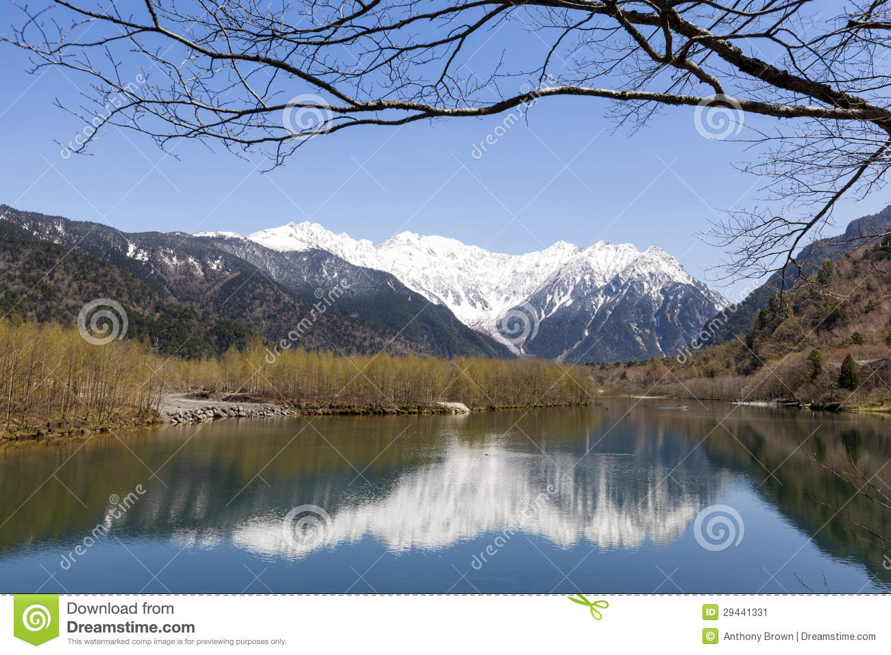 Snow Capped Hotaka Mountain Range Reflected In Taisho Pond In The