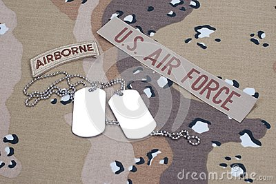 Us Army Airborne Tab With Blank Dog Tags On Camouflage Uniform Concept