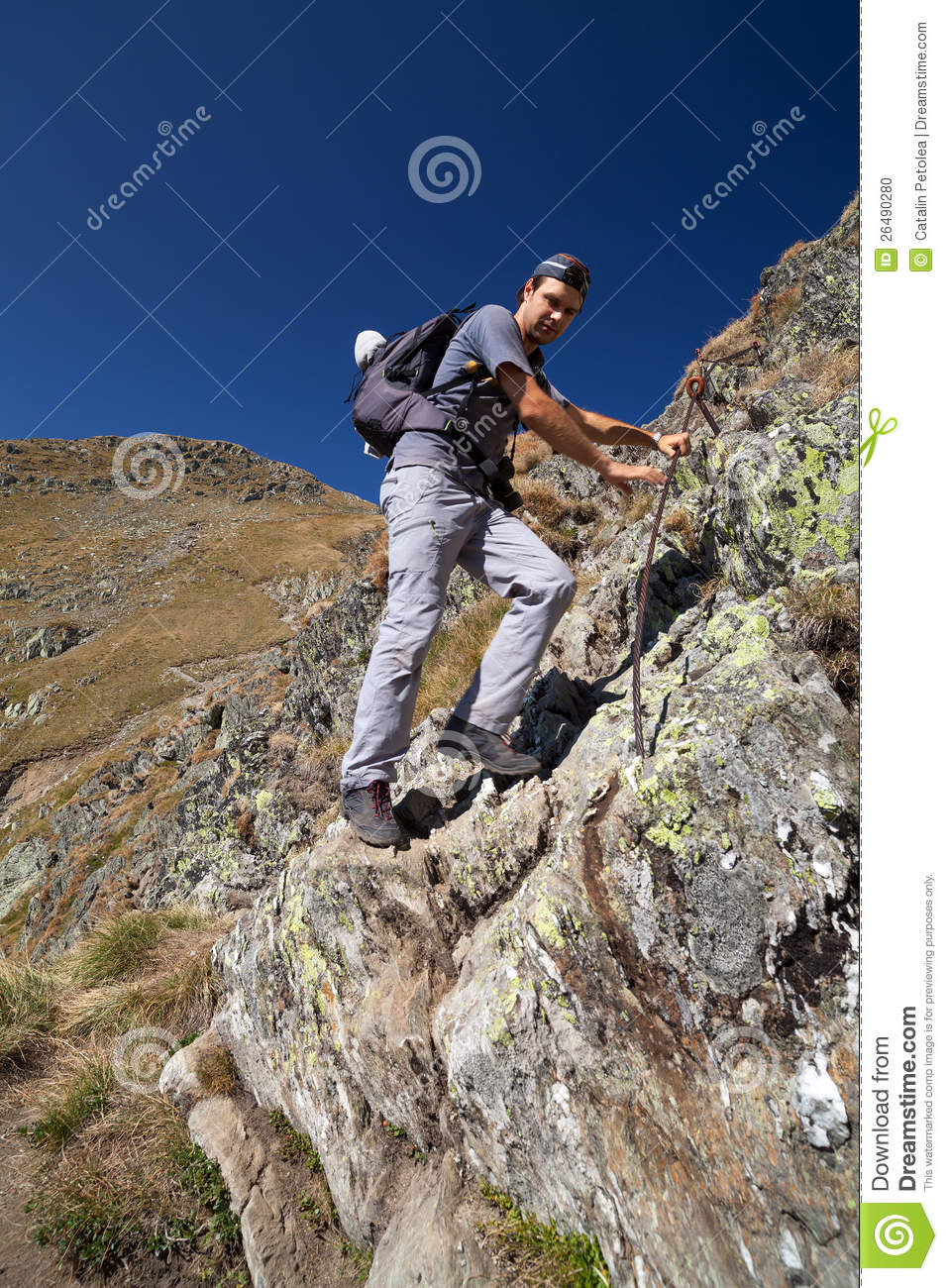 Man Hiking On Difficult Mountain Trail Stock Photo   Image  26490280