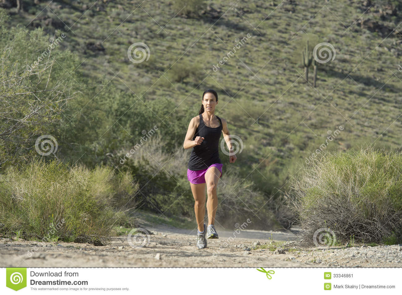Young Woman Trail Running Outdoors At South Mountain Park In Phoenix