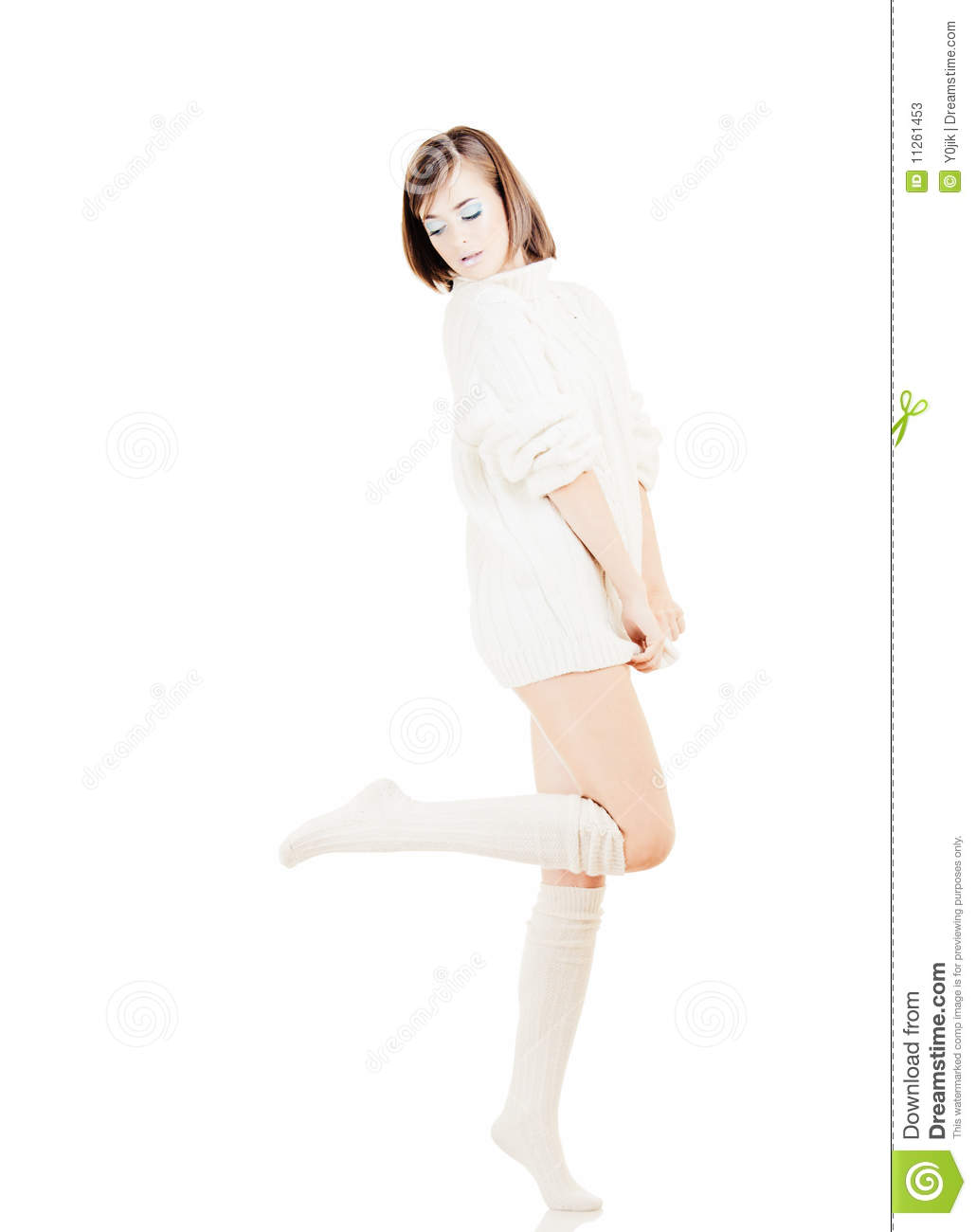 Young Pretty Girl In White Sweater On White Background