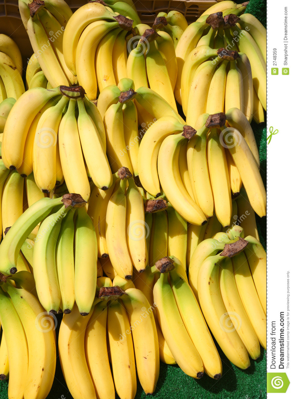 Lots Of Bunches Of Bananas Outside A Greengrocer Shop