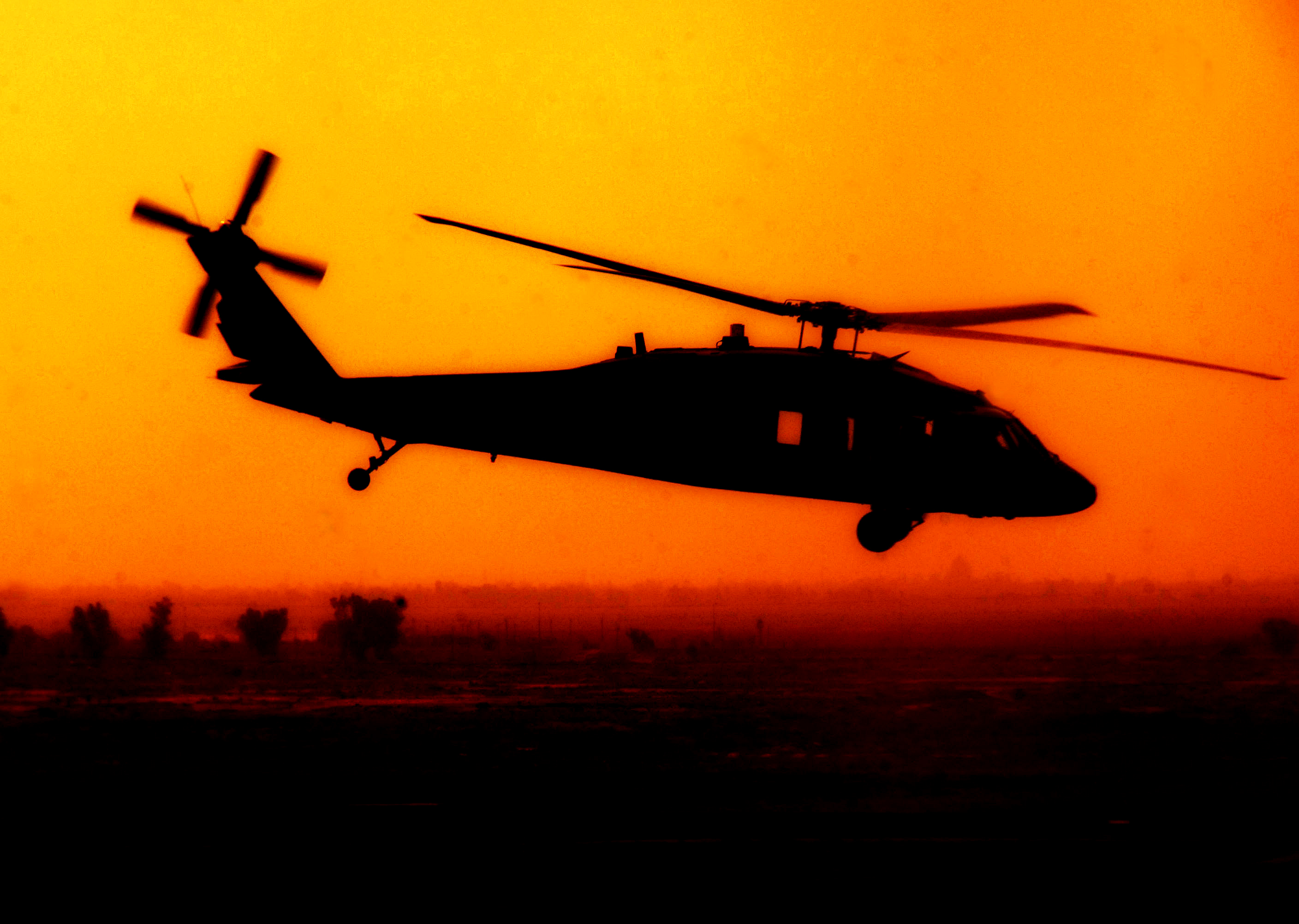 Black Hawk Helicopter Flying Over Baghdad   Acclaim Stock Photography