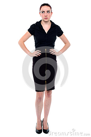 Frustrated Business Woman Standing With Her Hands On Her Hips Looking