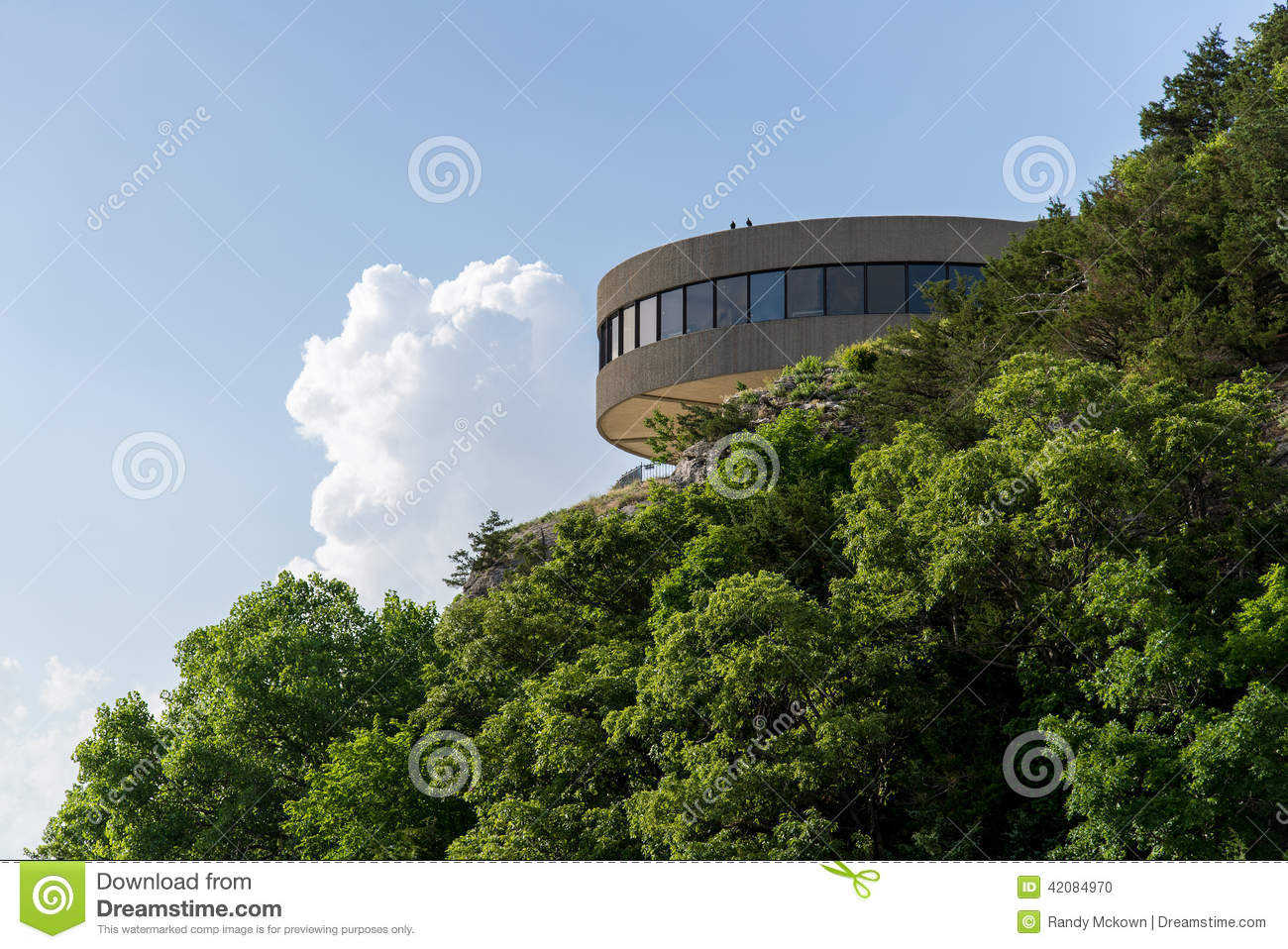 Modern Architecture Building On Hilltop Cliff Surrounded By Green