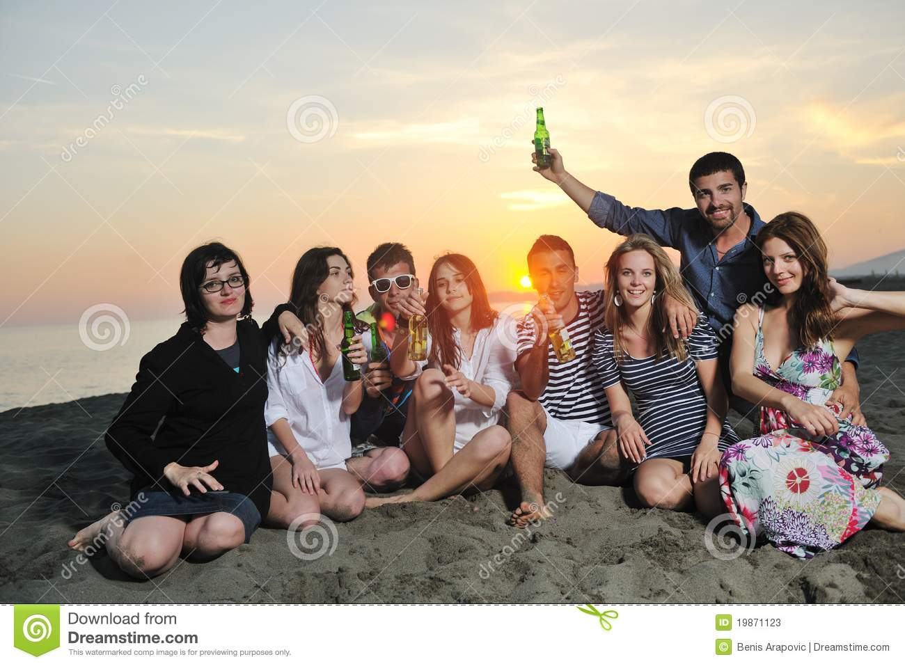 Group Of Young People Enjoy Summer Party At The Beach On Beautiful