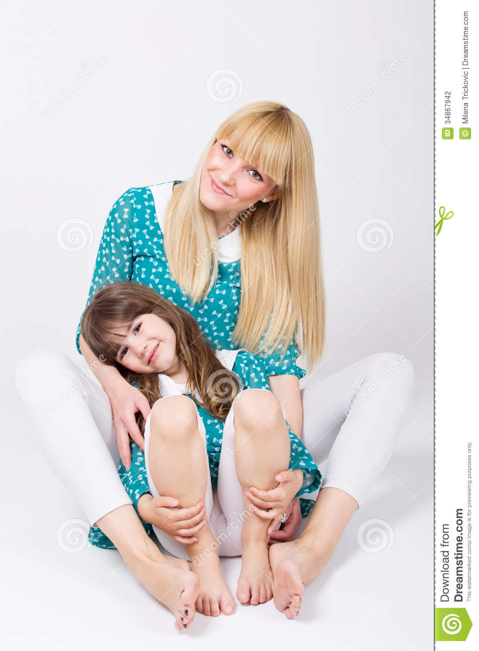 Beautiful Young Caucasian Blonde Mom And Cute Little Daughter Hugging