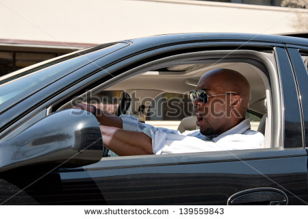 Man Driving A Car Is Expressing His Road Rage And Anger    Stock Photo