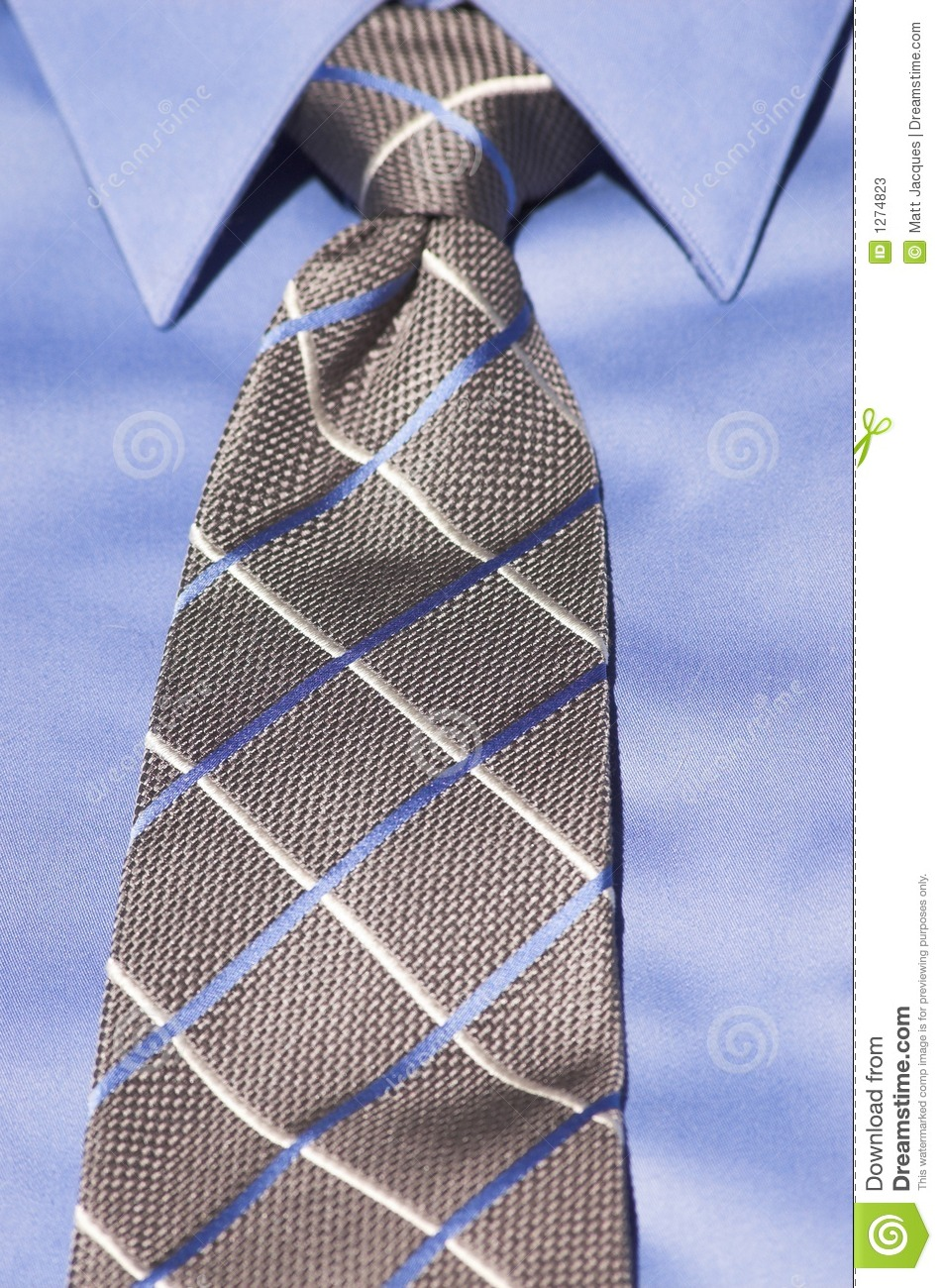 Close Up Of Blue Dress Shirt With Blue And White Striped Tie