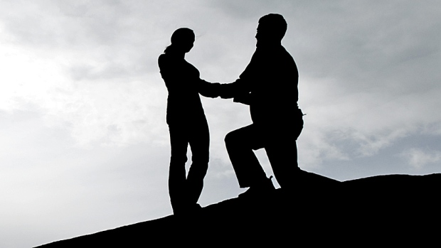 Silhouette Proposes To Another Silhouette   Istockphoto