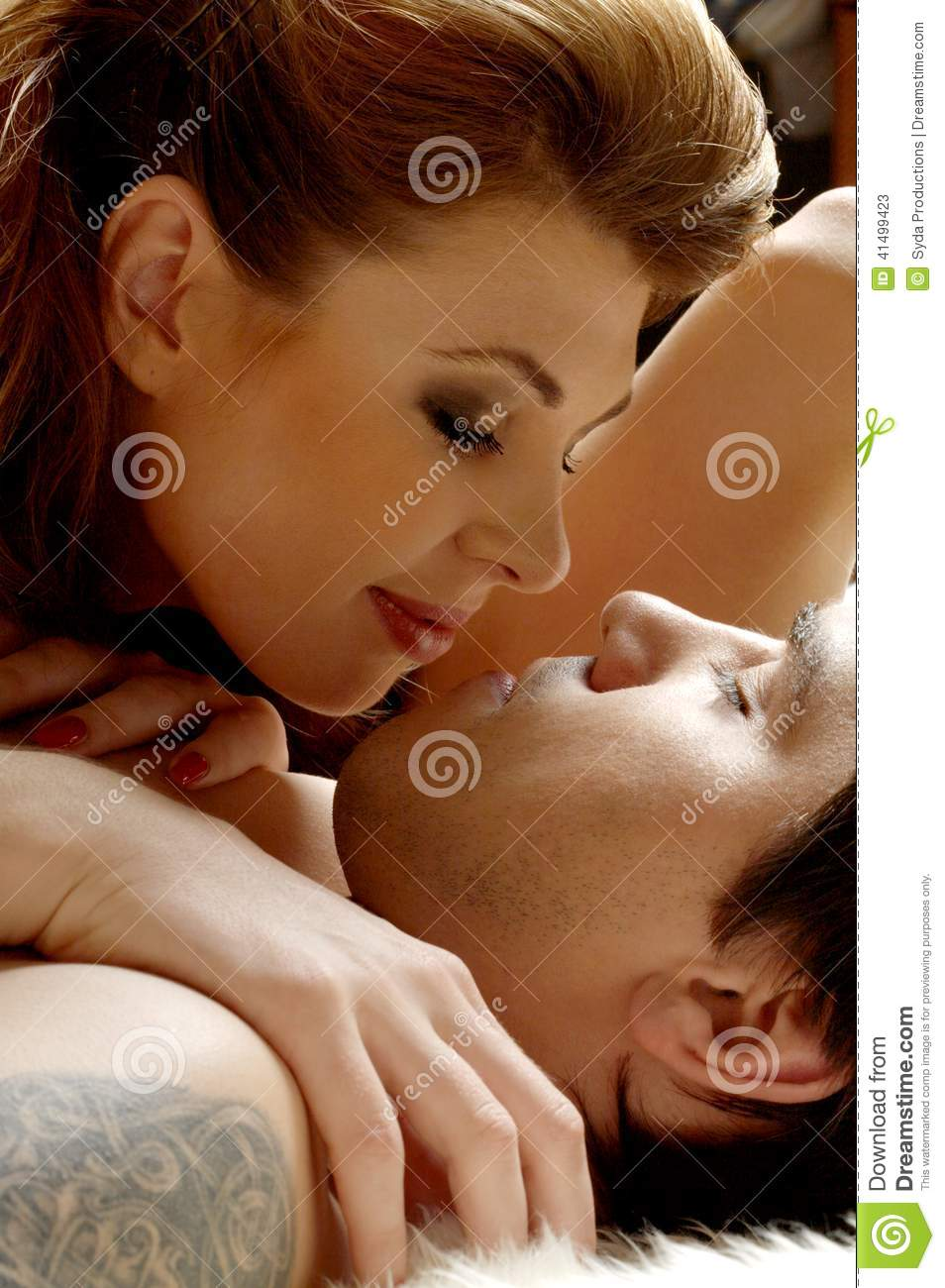 Picture Of Sweet Couple Cuddling In Bed
