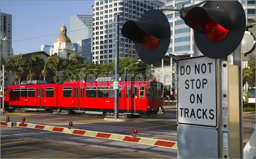 Downtown Scene At Railroad Crossing Red Trolley Car Passing Sign Pics