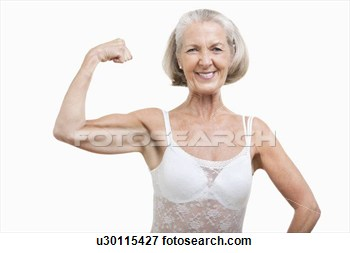 Portrait Of Senior Woman Flexing Muscles Against White Background View