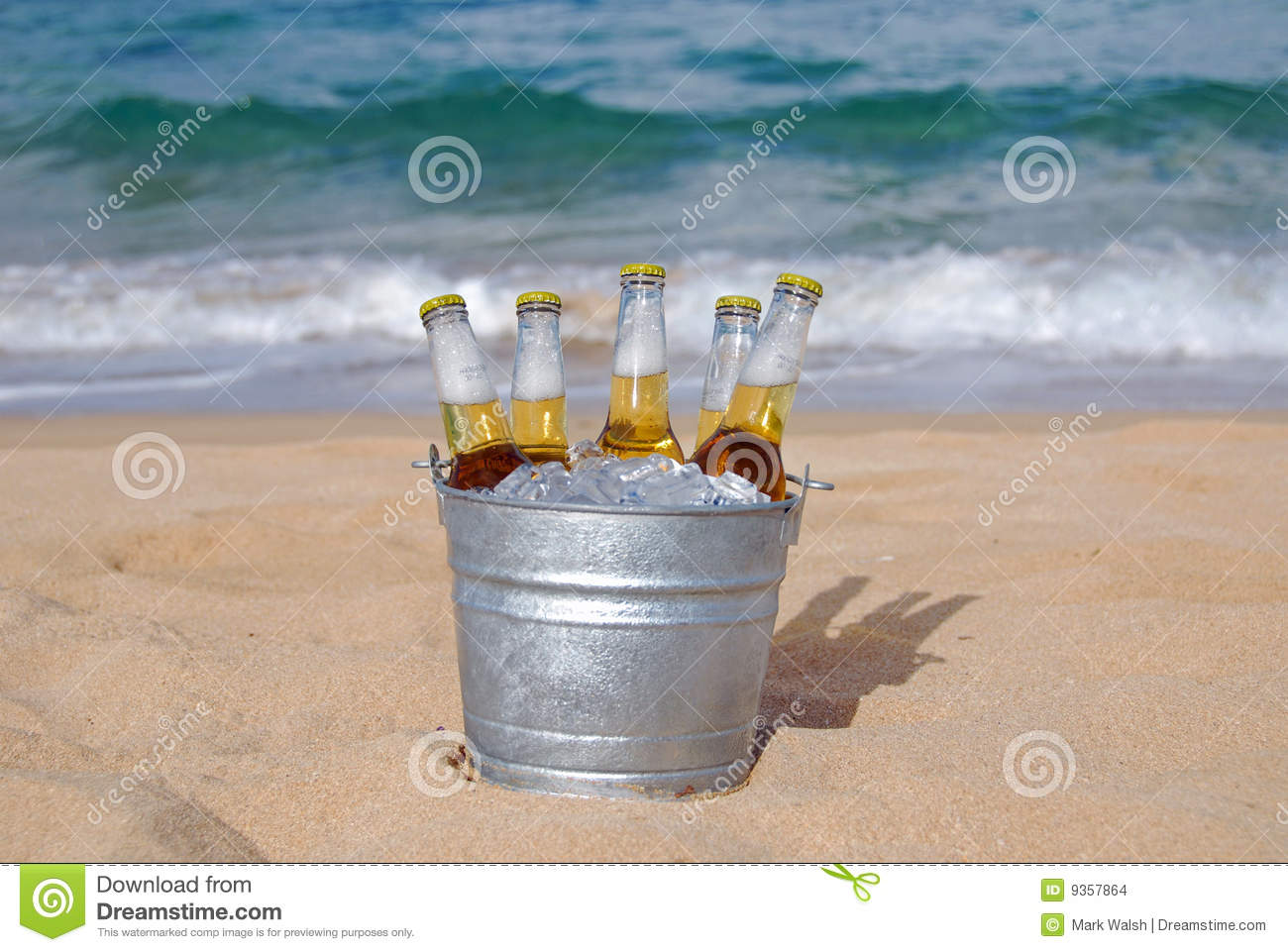 Bucket Of Ice Cold Beer On The Sandy Beach With The Ocean In The