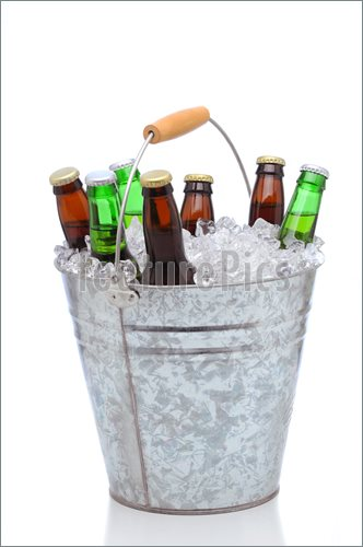 Picture Of Assorted Beer Bottles In A Bucket Of Ice  High Resolution